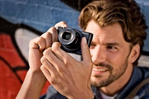 guy holding the Sony RX100 compact camera